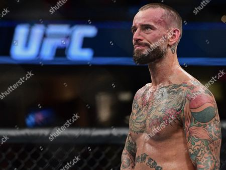 CM Punk CM Punk stands in the octagon after being defeated by Mickey Gall during a welterweight bout at UFC 203, in Cleveland