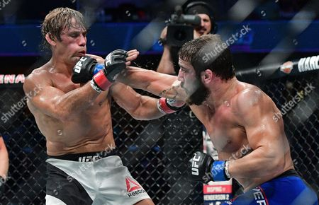 Jimmie Rivera, Urijah Faber Jimmie Rivera, right, punches Urijah Faber during a bantamweight bout at UFC 203, in Cleveland. Jimmy Rivera won via decision