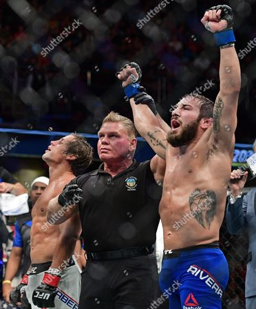 Jimmie Rivera, Urijah Faber Jimmie Rivera, right, has his arm raised by the referee after defeating Urijah Faber in a bantamweight bout at UFC 203, in Cleveland