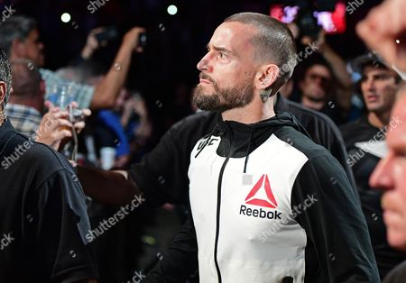 CM Punk CM Punk walks to the octagon before a welterweight bout at UFC 203, in Cleveland