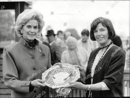 Stock Picture of Lady English (right) Wife Of Sir David English The Editor-in-chief Of The Daily Mail Presents A Silver Bowl To Mrs Audrey Andrews Part-owner Of Leisure Stakes Winner Gallic League At Lingfield Today. Box 706 100308168 A.jpg.