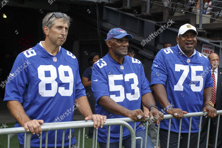 New York Giants legends Mark Bavaro (89), Harry Carson (53) and George Martin (75) looks on before the presentation at halftime during the NFL game between the New Orleans Saints and the New York Giants at MetLife Stadium in East Rutherford, New Jersey. The New York Giants won 16-13