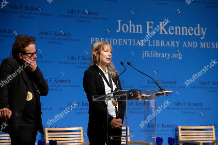 Tom Waits, Kathleen Brennan Musicians and husband and wife, Tom Waits, left, and Kathleen Brennan, right, address an audience after being presented with the PEN New England's Song Lyrics of Literary Excellence Award during ceremonies at the John F. Kennedy Library and Museum, in Boston