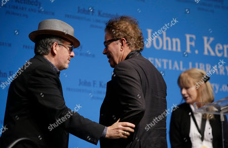 Elvis Costello, Tom Waits, Kathleen Brennan Musician Elvis Costello, left, congratulates musicians and husband and wife, Tom Waits, center, and Kathleen Brennan, right, after Waits and Brennan were presented with the PEN New England's Song Lyrics of Literary Excellence Award during ceremonies at the John F. Kennedy Library and Museum, in Boston