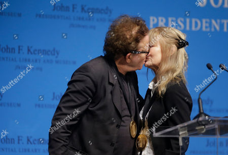 Tom Waits, Kathleen Brennan Musicians and husband and wife, Tom Waits, left, and Kathleen Brennan, right, embrace after being presented with the PEN New England's Song Lyrics of Literary Excellence Award during ceremonies at the John F. Kennedy Library and Museum, in Boston. Folk singer John Prine was also presented with the award during ceremonies Monday