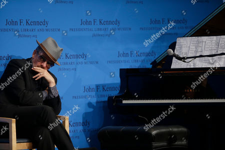 Elvis Costello Musician Elvis Costello listens during PEN New England's Song Lyrics of Literary Excellence Award ceremonies at the John F. Kennedy Library and Museum, in Boston. Tom Waits, his wife, Kathleen Brennan, and folk singer John Prine were presented with the award during ceremonies Monday