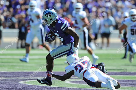 Florida Atlantic Owls defensive back Raekwon Williams (23) attempts a shoestring tackle on Kansas State Wildcats wide receiver Deante Burton (6)