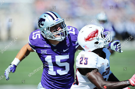 Stock Picture of Kansas State Wildcats wide receiver Zach Reuter (15) and Florida Atlantic Owls defensive back Raekwon Williams (23) both look for the ball