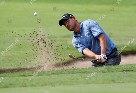 Britain's David Howell hits the ball out of a bunker during the 73th Italy Open Golf Championship in Monza, Italy