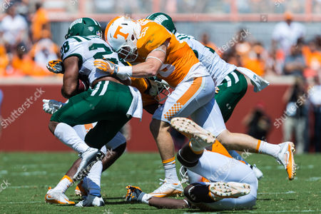 Colton Jumper #53 of the Tennessee Volunteers tackles Dorian Brown #28 of the Ohio Bobcats