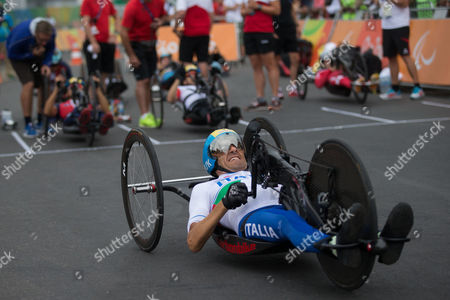 Italy's Luca Mazzone competes during the men's team relay H2-5 road cycling final at the Rio 2016 Paralympic games at Pontal beach in Rio de Janeiro, Brazil, . Italy's team Vittorio Pedestal, Luca Mazzone and Alessandro Zanardi won the gold medal, the US got silver and Belgium bronze