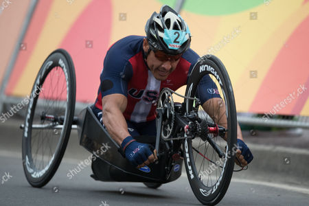 Oscar Sanchez, from the United States, competes during the men's team relay H2-5 road cycling final at the Rio 2016 Paralympic games at Pontal beach in Rio de Janeiro, Brazil, . Italy's team Vittorio Pedestal, Luca Mazzone and Alessandro Zanardi won the gold medal, the US got silver and Belgium bronze