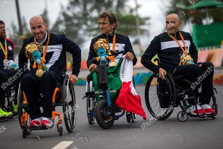 From left to right, Italy's Vittorio Podesta, Alessandro Zanardi and Luca Mazzone wear their gold medals on their necks after Italy won the men's team relay H2-5 road cycling final at the Rio 2016 Paralympic games at Pontal beach in Rio de Janeiro, Brazil, . The US got silver and Belgium bronze