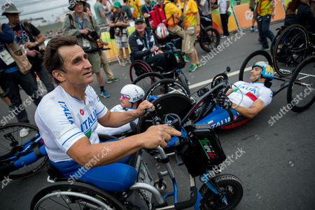 Italy's, from left, Alessandro Zanardi, Vittorio Podesta, and Luca Mazzone look on after winning the gold medal at the road men's cycling relay H2-5 final in the Rio 2016 Paralympic games at Pontal beach, in Rio de Janeiro, Brazil