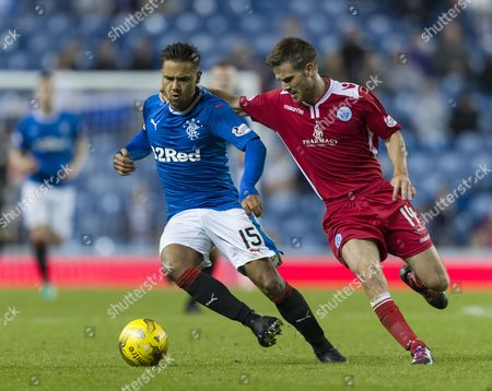 Harry Forrester of Rangers & Kyle Jacobs of Queen of the South during the Betfred Cup quarter-final tie between Rangers & Queen of the South match at Ibrox Stadium, Glasgow on 20th September