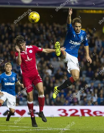 Grant Anderson of Queen of the South & Niko Kranjcar of Rangers during the Betfred Cup quarter-final tie between Rangers & Queen of the South match at Ibrox Stadium, Glasgow on 20th September