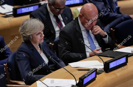 British Prime Minister Theresa May, left, listens alongside Lebanese Prime Minister Tammam Salam at a Leader's Refugee Summit during the 71st session of the United Nations General Assembly, at U.N. headquarters