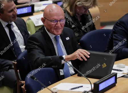 Lebanese Prime Minister Tammam Salam smiles at another head of state at a Leader's Refugee Summit during the 71st session of the United Nations General Assembly, at U.N. headquarters