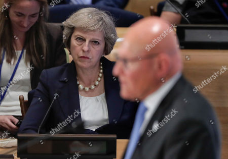 British Prime Minister Theresa May, left, listens as Lebanese Prime Minister Tammam Salam speaks at a Leader's Refugee Summit during the 71st session of the United Nations General Assembly, at U.N. headquarters