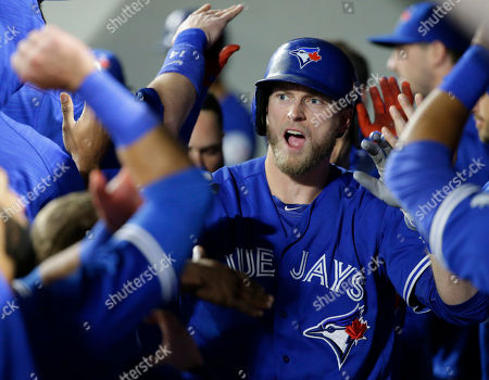 Michael Saunders Toronto Blue Jays' Michael Saunders is greeted in the dugout after he hit a two-run home run in the fourth inning of a baseball game, in Seattle. Blue Jays' Troy Tulowitzki scored on the play