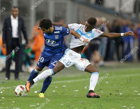 Steed Malbranque, Saif-Eddine Khaoui Lyon's French midfielder Steed Malbranque, left, challenges for the ball with Marseille's midfielder Saif-Eddine Khaoui, during the League One soccer match between Marseille and Lyon, in Marseille, southern France
