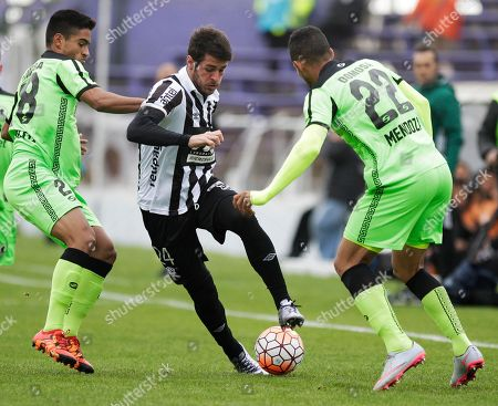 Jose Pinto of Venezuela's Zamora, center, fights for the ball with Uruguay's Wanderers Martin Rivas, left, and teammate Angel Faria during a Copa Sudamericana soccer match in Montevideo, Uruguay