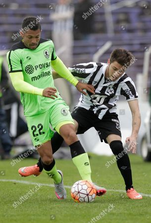 Angel Faria of Venezuela's Zamora, left, fights for the ball with Martin Rivas of Uruguay's Wanderers during a Copa Sudamericana soccer match in Montevideo, Uruguay