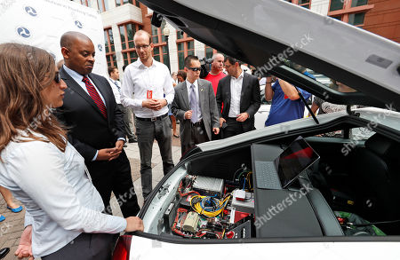 Anthony Foxx Transportation Secretary Anthony Foxx, second from left, looks at some of the computers in a car after a news conference about self-driving cars, in Washington. Obama administration officials are previewing long-awaited guidance that attempts to bring self-driving cars to the nation's roadways safely ' without creating so many roadblocks that the technology can't make it to market quickly