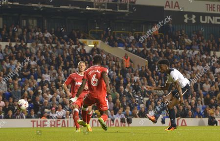 Joshua Onomah of Tottenham Hotspur scores the fourth goal as Paul Konchesky and Deji Oshilaja of Gillingham defend during the EFL Cup Third Round match between Tottenham Hotspur and Gillingham played at the White Hart Lane, London on 21st September 2016