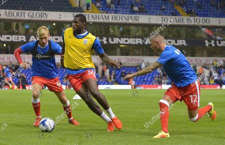 Josh Wright, Jay Emmanuel-Thomas, and Paul Konchesky of Gillingham warm-up during the EFL Cup Third Round match between Tottenham Hotspur and Gillingham played at the White Hart Lane, London on 21st September 2016