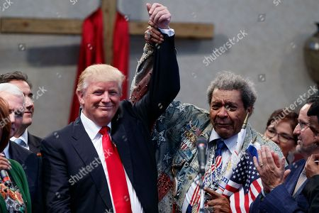 Donald Trump, Don King Boxing promoter Don King holds up the hand of Republican presidential candidate Donald Trump during a visit to the Pastors Leadership Conference at New Spirit Revival Center, in Cleveland, Ohio