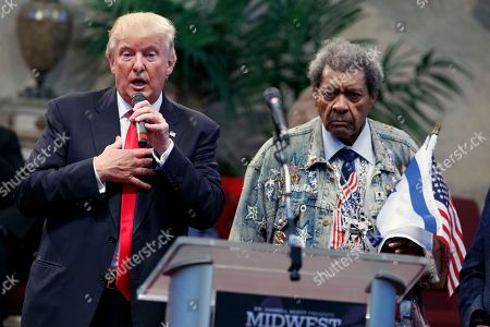 Donald Trump, Don King Boxing promoter Don King listens as Republican presidential candidate Donald Trump speaks to the Pastors Leadership Conference at New Spirit Revival Center, in Cleveland, Ohio