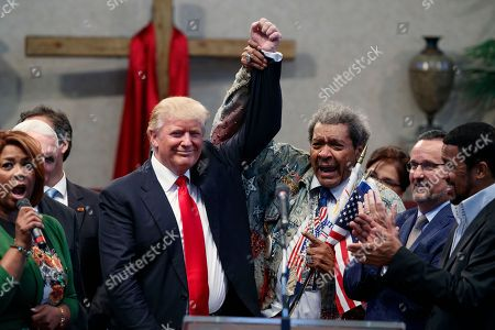 Donald Trump, Don King Boxing promoter Don King, right, holds up the hand of Republican presidential candidate Donald Trump during a visit to the Pastors Leadership Conference at New Spirit Revival Center, in Cleveland, Ohio