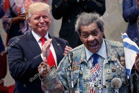 Donald Trump, Don King Republican presidential candidate Donald Trump applauds as he is introduced by boxing promoter Don King prior to speaking at the Pastors Leadership Conference at New Spirit Revival Center, in Cleveland, Ohio
