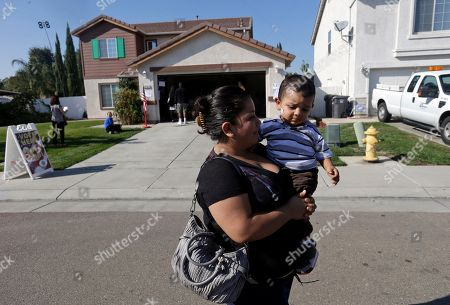 Yesenia Perez Yesenia Perez leaves a home which had been turned into a polling station with her 1-year-old son, Eduardo Sanchez, after voting in the Weston Ranch are of Stockton, Calif., . The neighborhood was heavily affected by foreclosures in the past few years. Perez said her family lost their home to foreclosure three years ago