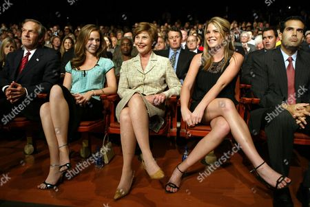 Stock Picture of BUSH EVANS First lady Laura Bush, center, and her twin daughters sit in the audience just before the start of the third and final presidential debate, at Arizona State University in Tempe, Ariz., . From left to right are Secretary of Commerce Don Evans, Barbara Bush, first lady Laura Bush, Jenna Bush and the president's nephew George P. Bush, son of Florida Gov. Jeb Bush
