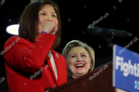 Hillary Clinton, Susan Shin Angulo Democratic presidential candidate Hillary Clinton laughs as she is introduced by Camden County, N.J., Freeholder Susan Shin Angulo at a campaign rally, in Blackwood, N.J