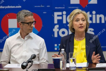 Stock Photo of Hillary Clinton, Peter Staley Democratic presidential candidate Hillary Clinton is joined by AIDS activist Peter Staley as she participates in a round table discussion with HIV/AIDS activists, at he campaign headquarters in New York