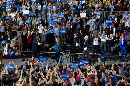 Bernie Sanders, Jane Sanders, Jonathan Jackson Jane Sanders walks to hug Jonathan Jackson, left, son of Rev. Jesse Jackson, as Democratic presidential candidate Sen. Bernie Sanders, I-Vt., right, waves to the crowd as he arrives to speak during a campaign rally at Chicago State University in Chicago