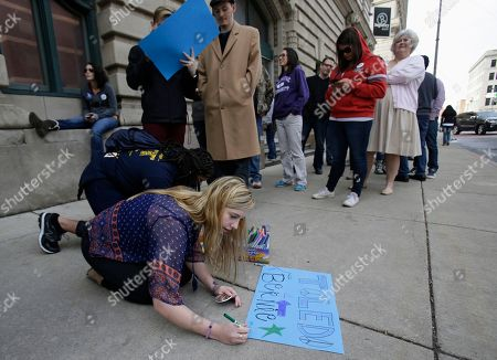 Jessica Fuller Jessica Fuller draws a sign as she waits in line to enter the SeaGate Convention Centre before Democratic presidential candidate, Sen. Bernie Sanders, I-Vt, speaks at a campaign rally, in Toledo, Ohio