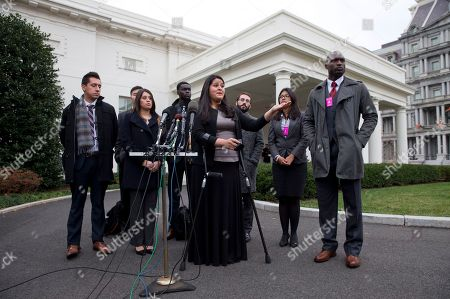 Stock Image of Lorella Praeli, Maria Sotomayor, Timilehin Wusu Lorella Praeli, 26, of New Haven, Conn., originally from Peru, and representing the group United We DREAM, with a group of immigrant youth who were eligible for the president's deferred action, speaks to the media after they met with White House Domestic Policy Director Cecilia Munoz at the White House in Washington. After coming out of the shadows and organizing on their own to advocate for immigration relief, many young immigrants known as dreamers are taking sides with political parties and working or volunteering for presidential campaigns