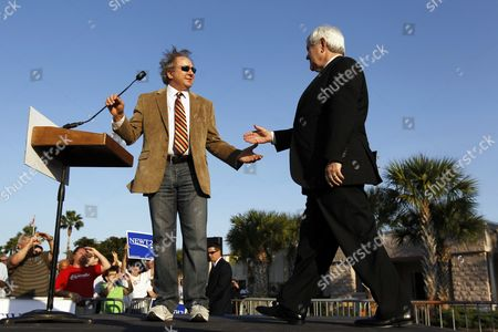 Newt Gingrich Michael Reagan, son of former President Ronald Reagan, greets Republican presidential candidate former House Speaker Newt Gingrich during campaign stop, in Fort Myers, Fla