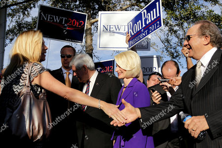 Newt Gingrich, Callista Gingrich, Michael Reagan Republican presidential candidate, former House Speaker Newt Gingrich, accompanied by his wife Callista, campaigns outside a polling place at the First Baptist Church of Windermere in Orlando, Fla., . Michael Reagan, son of former President Ronald Reagan is at right