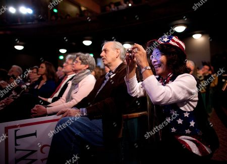Supporters of Republican presidential candidate, former House Speaker Newt Gingrich listen to him speak during a campaign stop at the Bing Crosby Theatre in Spokane, Wash