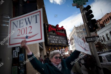 People holds signs outside a campaign event for Republican presidential candidate, former House Speaker Newt Gingrich at the Bing Crosby Theatre, in Spokane, Wash