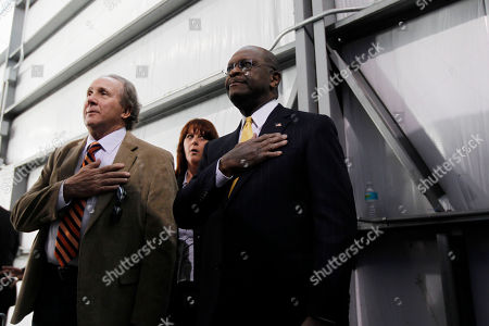 Herman Cain, Michael Reagan Michael Reagan, son of former President Ronald Reagan, left, and former Republican presidential candidate, Herman Cain, take the pledge during Republican presidential candidate former House Speaker Newt Gingrich campaign stop, in Tampa, Fla