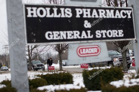 Joe Garvey Joe Garvey, a worker for the CARLY for America Committee super-pac, places signs outside Hollis Pharmacy & General Store before the arrival of Republican presidential candidate, businesswoman Carly Fiorina for a campaign stop at Hollis Pharmacy, in Hollis, N.H