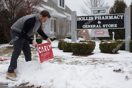 Stock Photo of Joe Garvey Joe Garvey, a worker for the CARLY for America Committee super-pac, places signs outside Hollis Pharmacy & General Store before the arrival of Republican presidential candidate, businesswoman Carly Fiorina for a campaign stop at Hollis Pharmacy, in Hollis, N.H