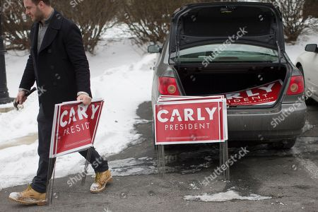 Stock Picture of Joe Garvey Joe Garvey, a worker for the CARLY for America Committee super-pac, carries signs to place outside Hollis Pharmacy & General Store before the arrival of Republican presidential candidate, businesswoman Carly Fiorina for a campaign stop at Hollis Pharmacy, in Hollis, N.H