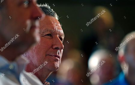 John Kasich Republican presidential candidate Ohio Gov. John Kasich listens as he is introduced at a town hall style meeting during a campaign stop in Greenland, N.H
